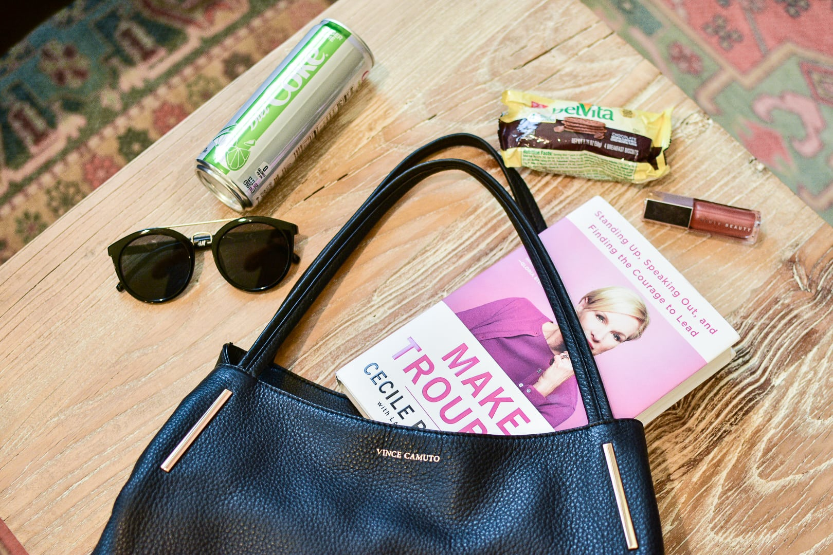 2de0161f45a2 See what s inside Leslie s Vince Camuto handbag and discover her 5 must-have  items to get her through the ...